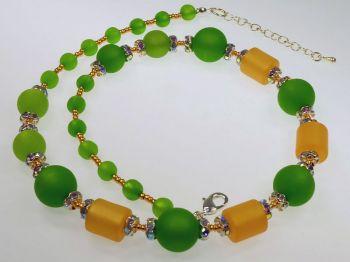 Glitzerkette in grün und maisgelb