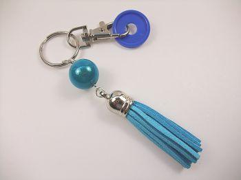 Schlüsselanhänger mit türkisblauer Quaste