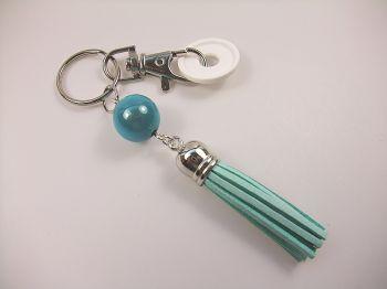 Schlüsselanhänger mit türkisgrüner Quaste