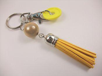 Schlüsselanhänger mit gelber Quaste