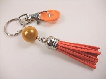 Schlüsselanhänger mit Quaste in orange