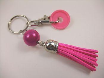 Schlüsselanhänger mit Quaste in pink