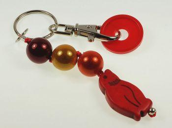 Schlüsselanhänger mit Pinguin in rot