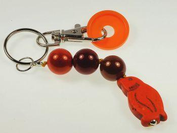 Schlüsselanhänger mit Pinguin in orange