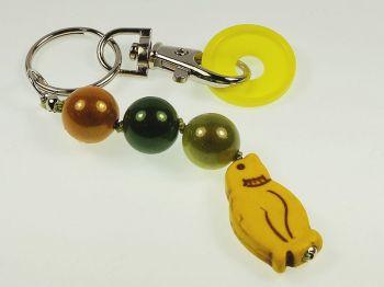 Schlüsselanhänger mit Pinguin in gelb